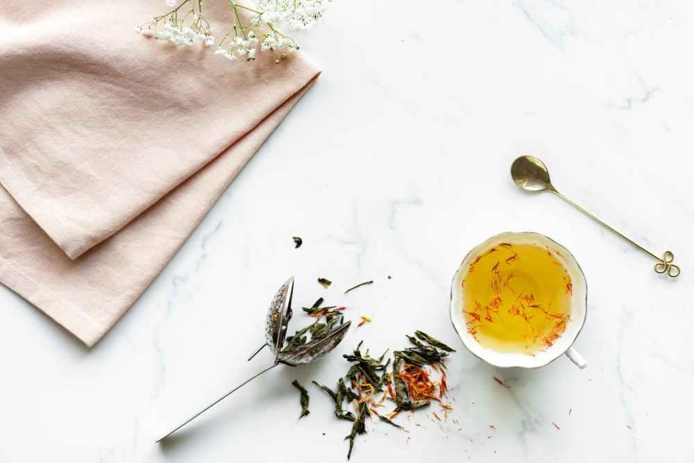 white ceramic teacup on white surface